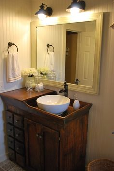 What a cool bathroom vanity. It's a great way to re-purpose an antique dry sink and add a modern feel with the vessel sink and faucet.