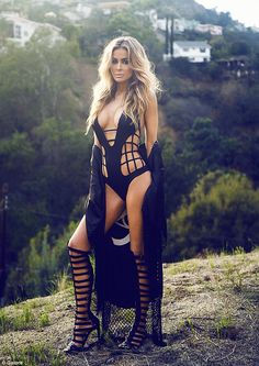 Edgy: The Starsky & Hutch star donned a strappy black monokini teamed with knee-high gladiator stilettos - posing on a hill with a residenti...