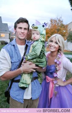 This is too cute! Rapunzel, Flynn Rider and Pascal! He definitely gets husband of the year. I can not think of a single guy I know that would be willing to dress up as a fairy tale character, no matter the circumstance.