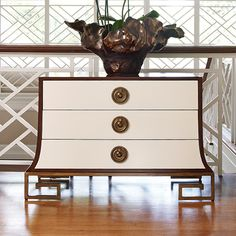 Global Views forever!  Always a little touch of glam in everything they do! -Sabre Chest-Ivory/Walnut