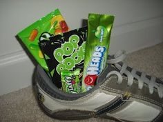 Leprechaun hid shoes around the house and left green treats in them for the kids to find that morning.  Fun idea!