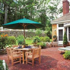 Herringbone is also a traditional choice for more formal landscapes and house styles. You can make the pattern with any rectangular brick or paver, but it's particularly eye-catching with these long ones that are laid with their narrow edges facing up. | Photo: Eric Roth | thisoldhouse.com