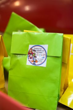 Finally, gift bags had tiny Super Hero toys and crayons, etc. in small bags sealed with the awesome logo that was on the invitations and the thank you cards.