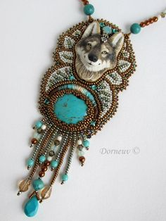 Bead embroidery wolf & turquoise pendant.