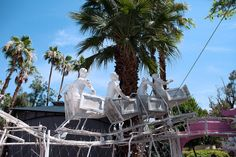 Grey Gardens With Robot Reindeer - One of many amazing robot art scenes made from found objects by artist in the heart and heat of Palm Springs.