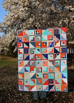 """Fantastic colors and layout in this """"Triangle/Log Cabin Quilt"""" by Natalie of Greenleaf Goods."""