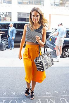 Outside her Manhattan hotel, Jessica Alba demonstrated her playful side in a sleeveless Houghton cropped top with floral appliqués and a languid asymmetric Osman skirt. [Photo by Josiah Kamau/BuzzFoto/FilmMagic]