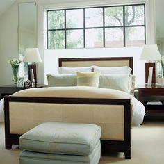 bedroom w/ cream and dark wood furniture