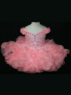 Size 6M Peach In Stock. Immidiate Shipping!This organza pageant dress Little Rosie by Bali Bali Fashions Pageant Dress 1019 features bare shoulders, beaded spaghetti straps and bodice, and flowers on the front. Completing this dress is a short ruffled skirt with multiple tiers. Your baby girl will look like a princess in this dress!