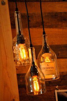 Recycled glass bottle hanging gin lamp pendant with Edison Lightbulb - Recycled Bottle Pendant Lamp, Hanging Bottle, Bottle Lamp with Edison Lightbulb. $52.00, via Etsy.