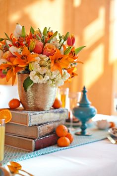 I love the mix of textures here, especially the shimmery gold vase cover in contrast to the natural flowers and fruit. this is fall without screaming it