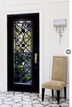 black door with iron grill