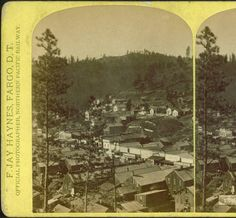 Deadwood from Signal Hill.  Image records north side of Deadwood Gulch.  Focuses on Main Street from present day Franklin Hotel toward Gold Street.  Taken before the 1879 fire. c. 1879. Photographer F. Jay Haynes.