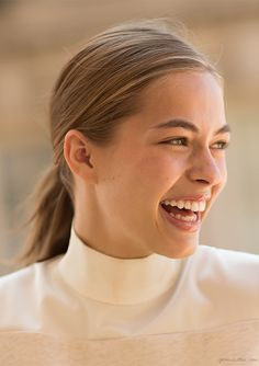 Teeth whitening, white turtleneck, low ponytail / Garance Doré
