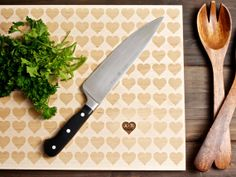 Carved heart engraved wood cutting board.