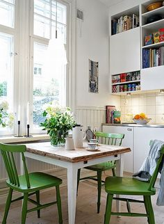 An old building dating back to 1903 and situated in Masthugget, Sweden | charming art-nouveau apartment | green chairs