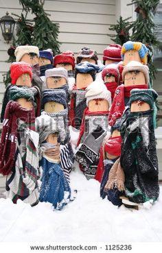 Wood Post Christmas Carolers in the Snow by Steven Ringler, via ShutterStock