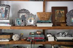 Author Mary Emmerling's bookcase in her home in Scottsdale.