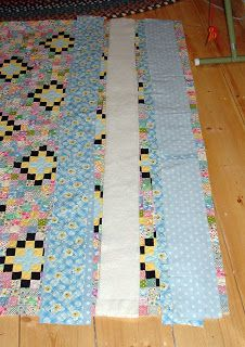 Periwinkle Quilting and Beyond: Tutorial, How to make your quilt bigger when it's already been quilted