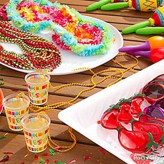 Kick off the Cinco de Mayo celebración with fiesta accessories! They'll love shakin' it in shot glass necklaces, chili pepper sunglasses and maracas -  ¡ole!