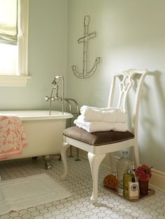 Bathroom with wire anchor wall sculpture.