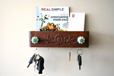 mail sorter and key rack made from a vintage sewing drawer