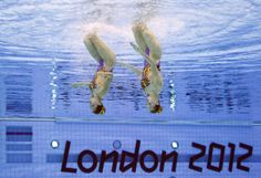 China's Liu Ou & Huang Xuechen in duet synchronized swimming competition.