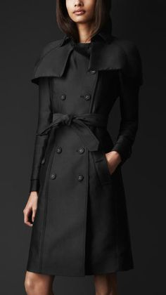Burberry Prorsum   Double Duchess Caped Trench Coat  also comes in BLACK.The caped trench coat is a modern interpretation of an archive design. Tailored in rich double duchess cotton silk, chosen for its understated lustre and texture, the silhouette is enhanced with an elegant canopy cape. Signature cuff straps and a hook-and-eye neck closure complete the clean pared-down lines. Retails for $2,595.