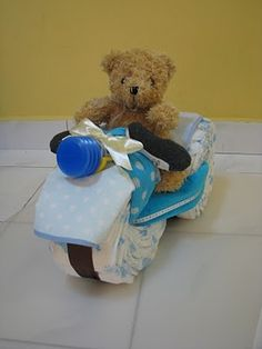Tricycle Diaper Cake for baby shower  http://labeillebakes.blogspot.com/2011/03/tricycle-diaper-cake-for-handsome-baby.html