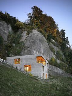 concrete house against outcrop