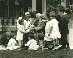 James Whitcomb Riley and children, circa 1915, at his home on Lockerbie Street, Indianapolis