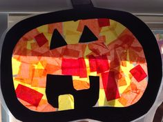 Contact paper and tissue paper Jack o' lantern