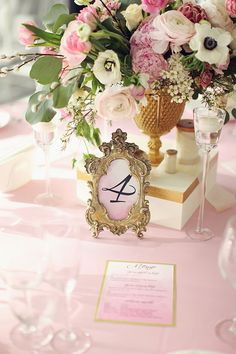 gold framed table numbers, photo by Sonya Khegay http://ruffledblog.com/romantic-moscow-wedding #gold #wedding #tablenumbers