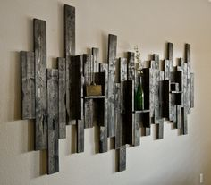 Rustic Display Shelf Decorative Wall Hanging - Pallet Project - who doesn't love to see something unexpected creating an interesting focal point (other than the TV!)