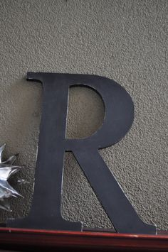 "Distressed custom wood letters 14"" tall - personalized for your wedding, living room, mantel, hallway. $18.20, via Etsy."