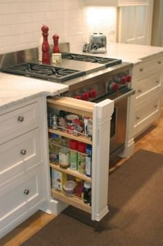 I like the spice cabinet and how the counter top swoops out near the stove.