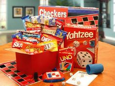 Family fun night with snacks and board games / card games. Could add to the pizze or movie as well. Travel size it for a road trip basket.