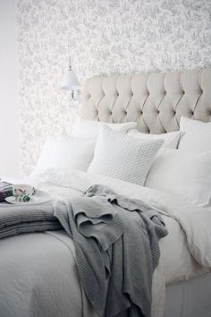 Get the look! Find a upholstered headboard like the one in this beautiful bedroom.