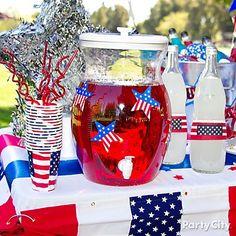 Cute cutouts make a basic beverage dispenser the star of a self-serve beverage station. drink tabl, juli drink, juli 4th, juli parti, blue, 4th of july, bless america, parti idea, july 4th food