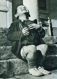 Famous pic. Austrian boy during WWII receiving new shoes....most children now days have NO idea!