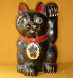 "Maneki Neko - Carved, Painted & Lacquered Wood. Late-Taisho to Early Showa Periods, Circa 1930's. 14"" x 8"" x 8"" (35cm x 20cm x 20cm)."