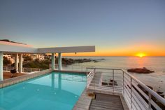 "This wonderful Triple Storey Property overlooks one of Cape Towns most unspoiled beaches in Bakoven and is nestled beneath the Twelve Apostles on the Cape Peninsula's famous coastline. The property, which is currently operating as a Boutique Guest House was built only meters above the splendor of ""Bali Bay"" and offers panoramic views of the Cape's natural wonders of mountain and sea even from the swimming pool you can enjoy this great view."