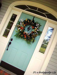 Light teal front door........love this.