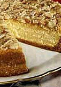 Almond-Crunch Pumpkin Cheesecake — A classic cheesecake made with pumpkin and spices is crowned with a brown sugar, coconut and almond topping that is broiled until golden and crunchy.