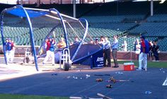 The Cubs' front office watches as Anthony Rizzo takes batting practice before Tuesday's game