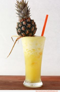 spiked pineapple cocktail | 2 cups fresh pineapple – core removed and chopped  2 tsp fresh ginger  2 tsp sugar*  1/2 cup water  Ice cubes  Splash of milk (optional)  2 shots of rum    Directions:    1. Add pineapple, ginger, sugar, water, and five ice cubes (and milk, if adding) into a blender, and blend until smooth and foamy.  2. Add five ice cubes into both glasses, along with a shot of rum.  3. Pour mixture into glasses and serve immediately while still foamy.