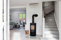 A white Skåne home with a fabulous woodburner