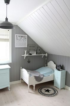cape cod bedroom with gray and white paneling