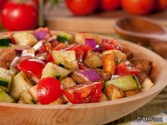 Tuscan Bread Salad - Mmmm, help yourself to a bowl of salad that includes plum tomatoes, cucumbers, onions, croutons, and more.