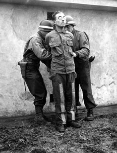 Operation Greif involved English-speaking German soldiers wearing captured Allied uniforms and vehicles as spies contrary to the Hague Convention rules of war to cause confusion in the rear of the Allied lines during the Battle of the Bulge. This is one of the spies being tied to a stake for execution in December 1944.